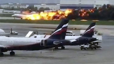This image taken from video provided by Instagram user @artempetrovich, shows the SSJ-100 aircraft of Aeroflot Airlines on fire during an emergency landing in Sheremetyevo airport in Moscow, Russia.