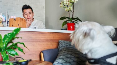 """""""I don't have kids, so I consider Bao'er my son,"""" says Albert Wu, a client of pet psychic Jasmine Shiau. MUST CREDIT: Photo for The Washington Post by An Rong Xu"""