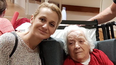 Concetta Onorato (right) with a family member at the Assisi aged care facility.