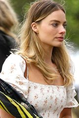 Margot Robbie in a white summer dress at her grandmother's burial.