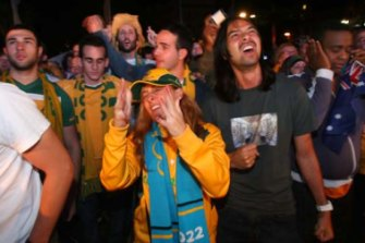 Heartbreak ... fans show their disappointment at the announcement that Qatar had won the right to host the 2022 World Cup
