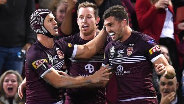 No.1 with a bullet: Queensland fullback Kalyn Ponga congratulates Corey Oates after setting up his try with a bullet pass.