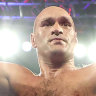 Tyson Fury celebrates after knocking down Deontay Wilder during their heavyweight championship bout in Las Vegas.