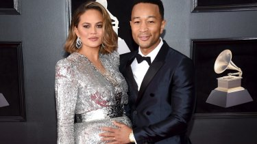 A pregnant Chrissy Teigen, left, with husband John Legend at the 60th annual Grammy Awards, in New York in January.