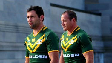 Cameron Smith (left) and Matt Scott representing the Kangaroos back in 2013.