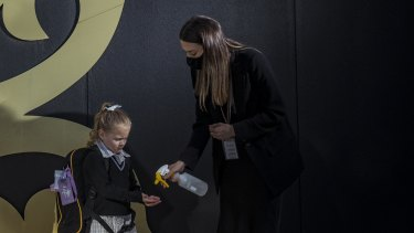 Bacchus Marsh Grammar students, including prep Charlotte Jacobson, have their hands sanitised as they return to school after lockdown six ended overnight.