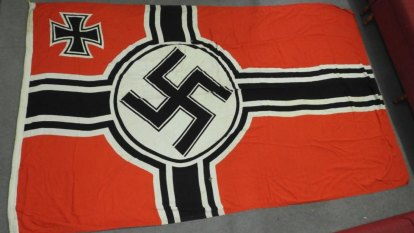 'Emblem of pure inhumanity': WWII Nazi flag for sale in Queensland