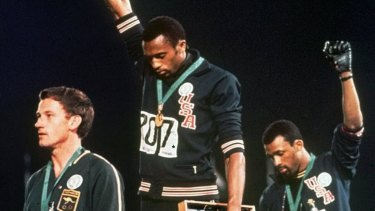 Tommie Smith (centre) and John Carlos (right) and Australian Peter Norman at the 1968 Olympics.