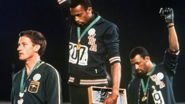 US athletes Tommie Smith, centre, and John Carlos and Australian Peter Norman, left, at the 1968 Olympics.