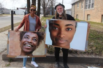 Filmmaker George Gittoes with Chantal Scott, whose sister Kaylyn Pryor (in posters) was murdered.