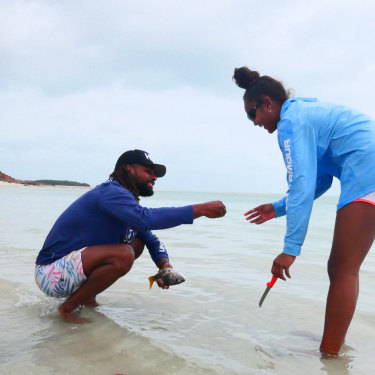 Mills with his niece, Miia, cleaning fish at Thursday Island.