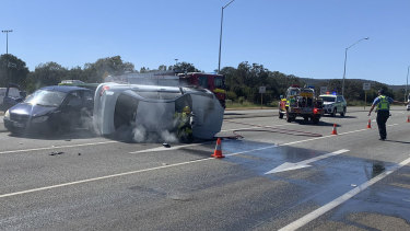 The driver of the stolen car failed to stop for police before colliding with two cars near Tonkin Highway.