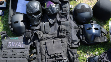 Face masks, SWAT vests and armoured helmets were also found.
