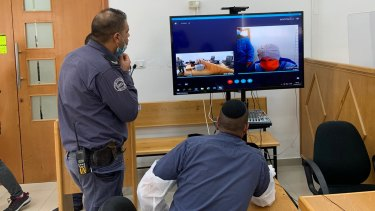 Accused child sex abuser Malka Liefer appears via video link in an Israeli court.