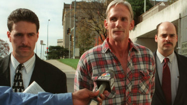 Wesley Purkey pictured in 1998 at his arrest for the rape and murder of a 16-year-old girl.