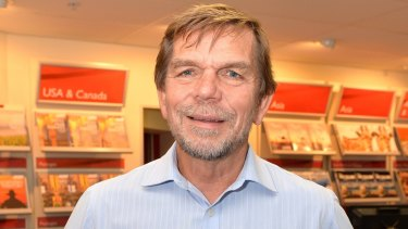 Flight Centre chief executive Graham Turner says the company will not be radically reducing bricks-and-mortar stores.