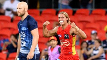 Sparkling form: Jeremy Sharp celebrates after slotting a goal for Gold Coast at Metricon Stadium.