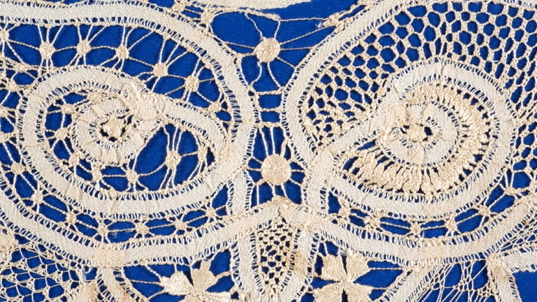 Fine lacework on a blue background.