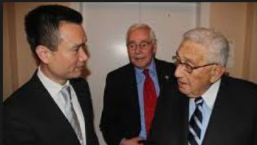 The mystery princeling, known as Ye Jianming with Henry Kissinger in 2013.
