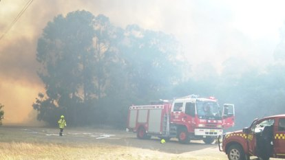 Weary firefighters battle 74 blazes across NSW with 'no reprieve' in sight