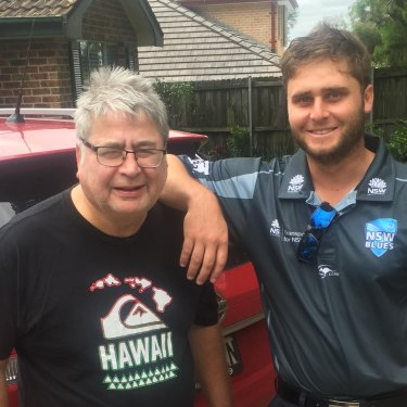 Nick Bertus and his dad, Nigel, outside the family home.