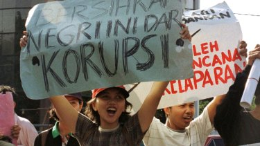 """Old problem: Students hold up posters reading """"Clean the country of corruption"""" during an anti-government protest in Jakarta in 1977."""