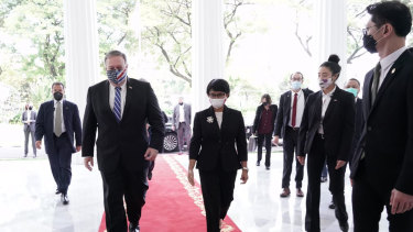 Walk this way: US Secretary of State Mike Pompeo with Indonesia's Foreign Minister Retno Marsudi in Jakarta on Thursday.