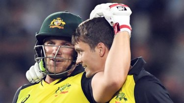 New order: Aaron Finch, left, with Alex Carey.