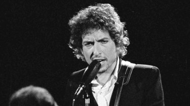 Bob Dylan performing with The Band at the Forum in Los Angeles in 1974.