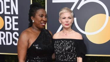 Tarana Burke, left, and Michelle Williams arrive at the 75th annual Golden Globe Awards at the Beverly Hilton Hotel in 2018.