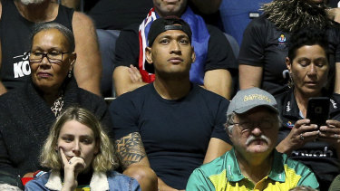 Israel Folau watches his wife Maria play in the Netball World Cup match between New Zealand and Australia in England on Thursday.
