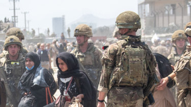 British troops try to help evacuate some Afghans amid chaotic scenes outside the airport in Kabul.