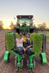 Alanna Rennie takes a break from work by harvesting chillies on her family farm.