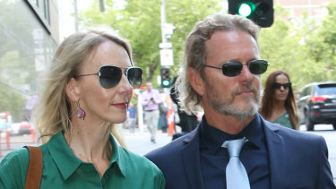 Craig McLachlan and his partner Vanessa Scammell leave Melbourne Magistrates Court on Wednesday.