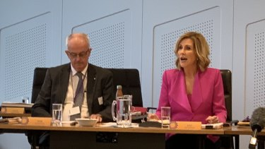 Former Police Commissioner Bob Atkinson AO APM and Kay McGrath OAM at the first Domestic and Family Violence Prevention Council meeting in February last year.