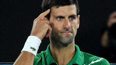 Novak Djokovic gestures.