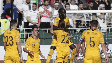 On target: Australia celebrate Awer Mabil's goal against Palestine.