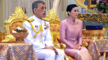 Thailand's King Maha Vajiralongkorn (left) sits with Queen Suthida Vajiralongkorn Na Ayutthaya in a photo released on Wednesday.