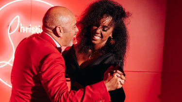 Christian Louboutin and 'The Voice' coach Kelly Rowland hit the dancefloor in the Loubi lounge.