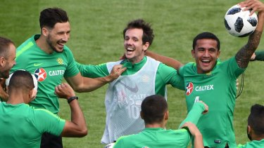 One of the boys: Robbie Kruse (white vest) and the Socceroos ham it up at the World Cup.