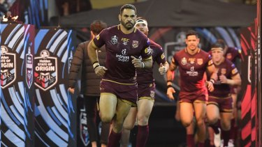 Departing legend: Greg Inglis leads the Maroons onto the MCG arena for game one of Origin in 2018.