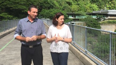 Craig Crawford, pictured with Premier Annastacia Palaszczuk, says the extent of the risks to residents around the dam are not yet well understood.