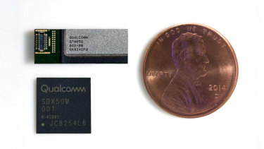 A Qualcomm 5G modem (lower). This would need to be used in conjunction with at least three RF modules (upper) to connect to 5G networks. US penny (about the size of a five cent coin) for scale.