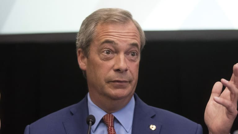 Nigel Farage, leader of the UK Independence Party (UKIP), gestures whilst speaking during a news conference to announce his resignation as UKIP party in July.