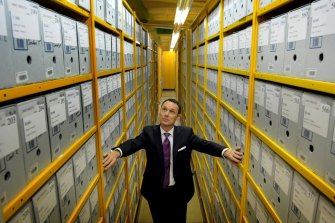 National Archives Director-General David Fricker stands among the archives boxes at its Canberra repository in 2012.