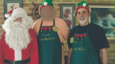 Perce Hillyer (right) gets into the festive spirit with fellow volunteers.