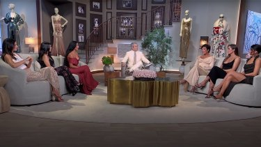From left, Kendall Jenner, Kourtney and Kim Kardashian, Andy Cohen, Kris Jenner, Khloe Kardashian and Kylie Jenner during the Keeping Up With the Kardashians reunion special.