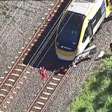 Car debris at the base of the Brisbane train at Lindum station.