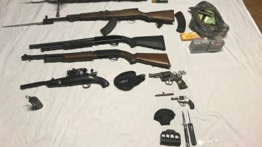 A cache of weapons was netted during the raid, according to police.
