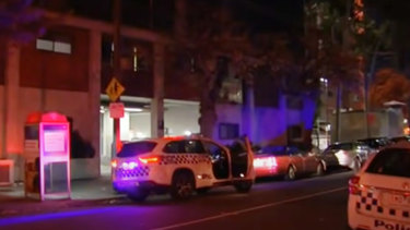 Police outside the South Yarra apartment block.